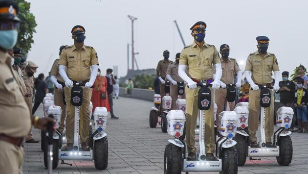 Police personnel ride segways during their launch for them to patrol, at Worli Sea Face in Mumbai on January 2. Maharashtra is maintaining a trend of low Covid-19 cases for over two months. For the last 19 consecutive days, it is reporting fewer than 4,000 cases. However, there are concerns for a surge in cases this month. (Kunal Patil/PTI)