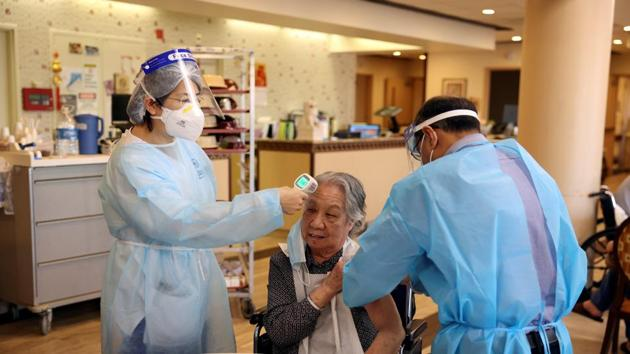 A resident at Hamilton Park Nursing and Rehabilitation, a nursing home facility, receives the coronavirus disease (Covid-19) vaccine from Walgreens Pharmacists in Brooklyn, New York, US.(REUTERS)