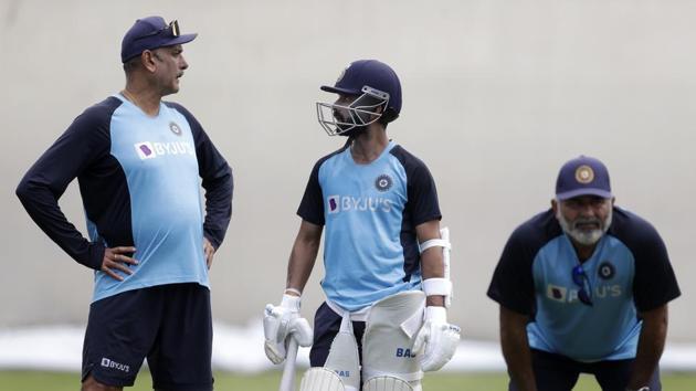 India's captain, Ajinkya Rahane, center, talks with head coach Ravi Shastri Indian players train in Sydney, Tuesday, Jan. 5, 2021, ahead of their cricket test against Australia starting Thursday.(AP)