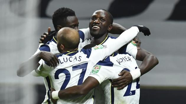 Tottenham's team players celebrate after Moussa Sissoko scored their side's first goal during the EFL Cup semi-final soccer match between between Tottenham Hotspur and Brentford at Tottenham Hotspur Stadium in London, England, Tuesday, Jan. 5, 2021.(AP)