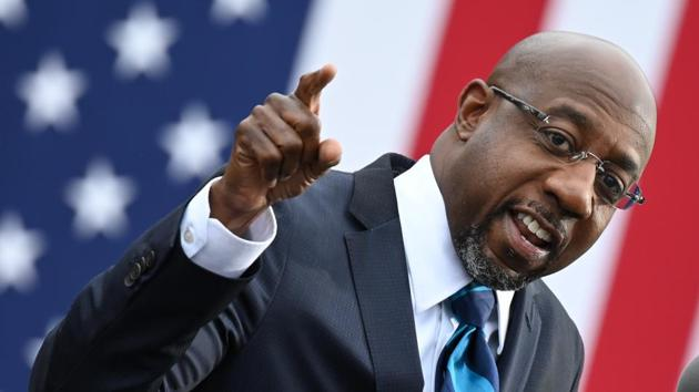 Democrat Raphael Warnock won the first of two critical runoff elections in Georgia that will decide control of the US Senate at the outset of Joe Biden's presidency.(AFP file)