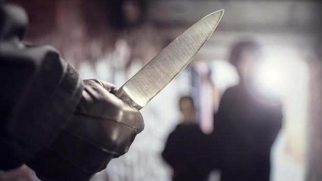 Criminal with knife weapon threatening woman and child in underpass crime(Getty Images/iStockphoto)