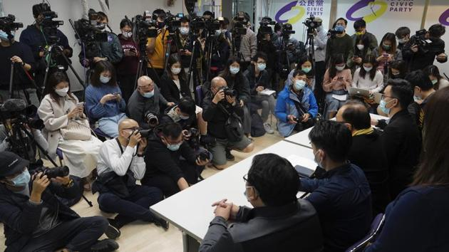Pro-democratic party members respond to the mass arrests during a press conference in Hong Kong.(AP Photo)