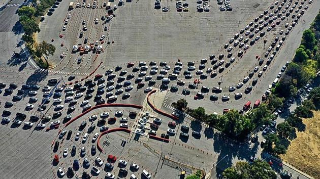 People line up for Covid tests in their vehicles at Dodger Stadium in Los Angeles, California.