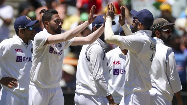 India's MD Siraj, second left, is congratulated by teammates(AP)