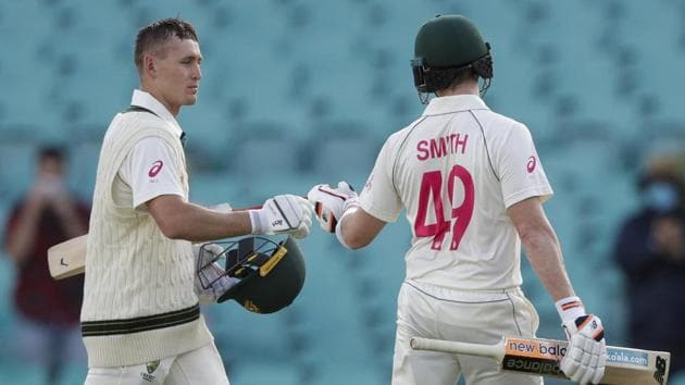 Australia's Steve Smith and Marnus Labuschagne, left, walk from the field following play on day one of the third cricket test between India and Australia at the Sydney Cricket Ground, Sydney, Australia, Thursday, Jan. 7, 2021. (AP Photo/Rick Rycroft)(AP)