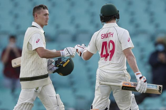 Australia's Steve Smith and Marnus Labuschagne, left, walk from the field following play on day one of the third cricket test between India and Australia at the Sydney Cricket Ground, Sydney, Australia, Thursday, Jan. 7, 2021. (AP Photo/Rick Rycroft) (AP)