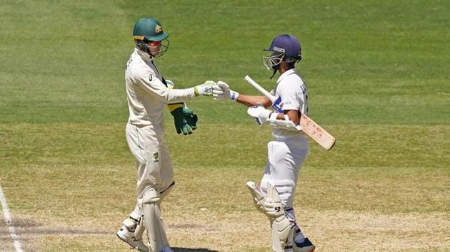 Tim Paine of Australia congratulates India's Ajinkya Rahane after India won the match during day four of the second test match between Australia and India at The MCG, Melbourne, Australia, December 29, 2020. AAP Image/Scott Barbour via REUTERS ATTENTION EDITORS - THIS IMAGE WAS PROVIDED BY A THIRD PARTY. NO RESALES. NO ARCHIVE. AUSTRALIA OUT. NEW ZEALAND OUT(via REUTERS)