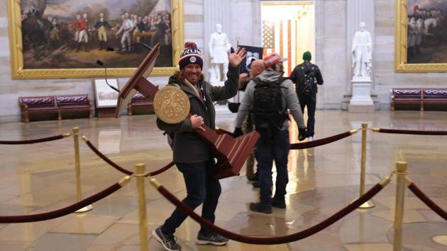 "Protesters after breaching the US Capitol Building on January 6 in Washington. ""These are the things and events that happen when a sacred landslide election victory is so unceremoniously & viciously stripped away from great patriots who have been badly & unfairly treated for so long,"" Trump wrote in a message that was later deleted by Twitter. He added, ""Go home with love & in peace. Remember this day forever!"" (Win McNamee / Getty Images / AFP)"
