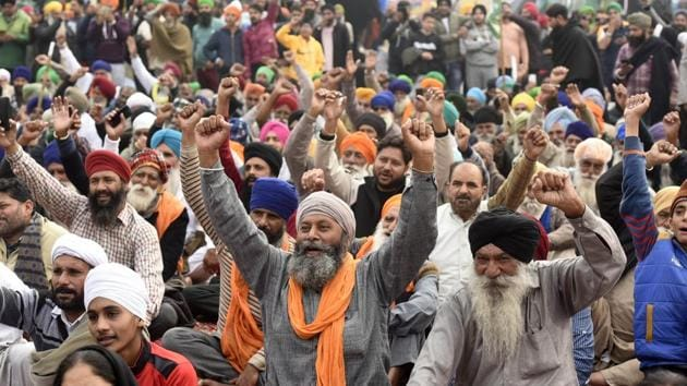 Farmers raising slogans during their protest at Singhu border on January 6. Farmers, primarily from Punjab and Haryana, have been camping at several Delhi border points since November 28, demanding repeal of the laws, and a legal guarantee on minimum support prices for their crops, among other issues. (Biplov Bhuyan / HT Photo)