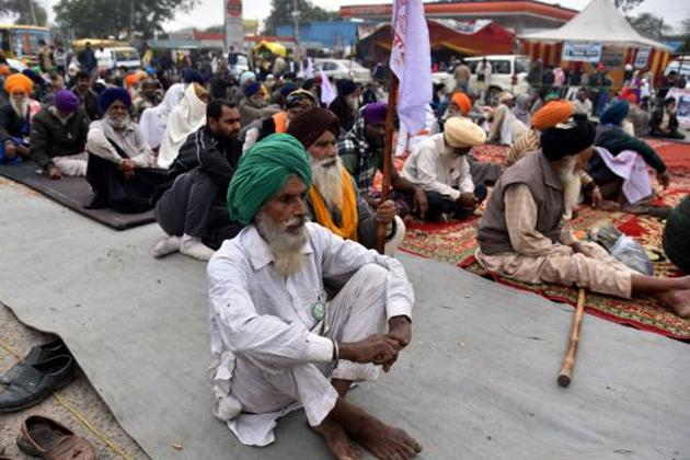 A farmer sitting during an ongoing protest against the new farm laws, Singhu border, New Delhi, January 7, 2020(ANI)