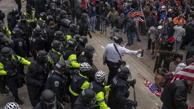 Pepper spray is used against demonstrators as they breach the US Capital building grounds in Washington.(Bloomberg)