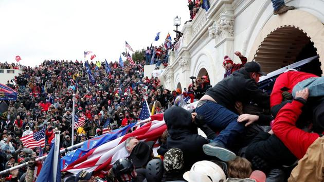 Pro-Trump protesters storm into the Capitol building during clashes with police, during a rally to contest the certification of the 2020 US presidential election results by the US Congress, in Washington.(Reuters image)