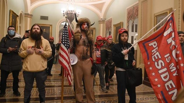 Supporters of US President Donald Trump in the US Capitol on January 6. The mob's storming of Congress prompted outrage, mostly from Democrats but from Republicans as well, as lawmakers accused Trump of fomenting the violence with falsehoods about election fraud. (Saul Loeb / AFP)