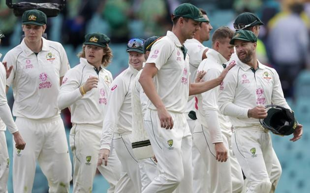 Australian players walk from the field at the end of play on day two of the third cricket test between India and Australia at the Sydney Cricket Ground, Sydney, Australia, Friday, Jan. 8, 2021. (AP Photo/Rick Rycroft) (AP)