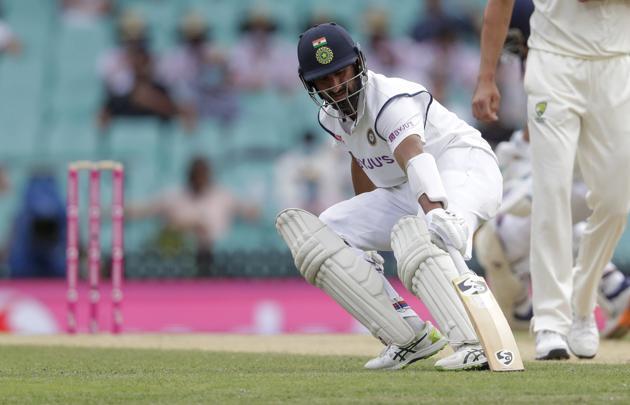 India's Cheteshwar Pujara runs a single during play on day two of the third cricket test between India and Australia at the Sydney Cricket Ground, Sydney, Australia, Friday, Jan. 8, 2021. (AP Photo/Rick Rycroft) (AP)