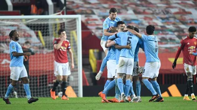Manchester City's Fernandinho celebrates scoring their second goal with teammates.(Pool via REUTERS)
