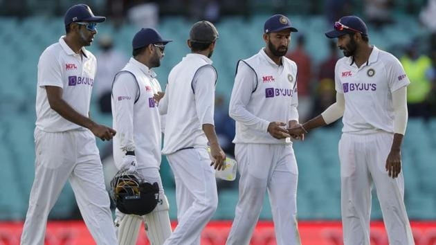 Indian players walk from the field at the end of play(AP)