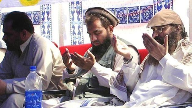 In this June 28, 2008, file photo, suspected mastermind of the 2008 Mumbai attacks, Zaki-ur-Rehman Lakhvi, prays with Syed Salahuddin, chief of Hizbul Mujahideen or United Jehad Council, in Muzaffarabad in Pakistan-occupied Kashmir.(AP Photo)
