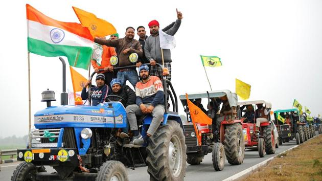 Farmers participate in a tractor rally to protest against the newly passed farm bills, on a highway on the outskirts of New Delhi.(REUTERS)