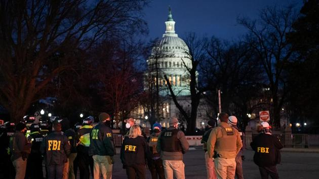 Federal Bureau of Investigation (FBI) agents arrive at Capitol Hill in Washington, D.C.(Bloomberg Photo)