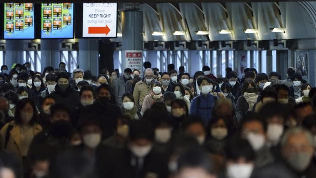 A station passageway is crowded with commuters during rush hour on January 8 in Tokyo. The emergency hands power to local governments to urge residents to stay home after 8 p.m. and order some businesses to limit operations, though authorities can't force compliance for now. New restrictions could be expanded to cover more of the country if infections worsen, with areas including Osaka also experiencing a surge. (Eugene Hoshiko / AP)