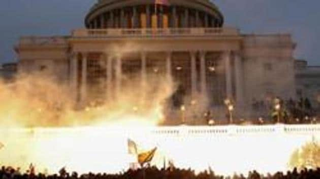 The Alliance to Save and Protect America from Infiltration by Religious Extremists and Coalition of Americans for Pluralism in India condemned the presence of Indian tricolour by rioting mobs at the Capitol Hill.(REUTERS)