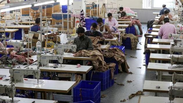 Workers stitch garments at a factory of an apparel shop in Jaipur.(REUTERS)