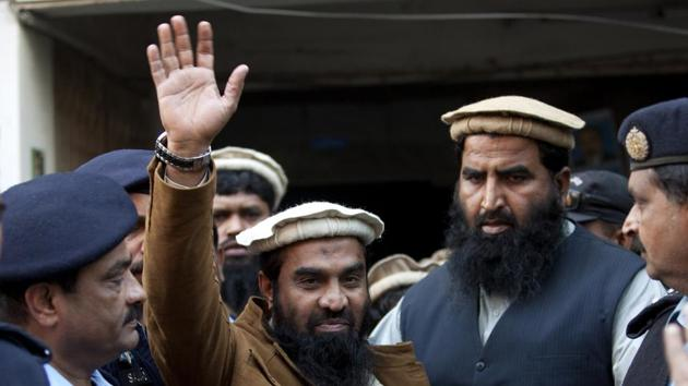 In this January 1, 2015, file photo, police officers escort Zakiur Rehman Lakhvi, center, the main suspect of the Mumbai terror attacks in 2008, after his court appearance in Islamabad, Pakistan.(AP file)