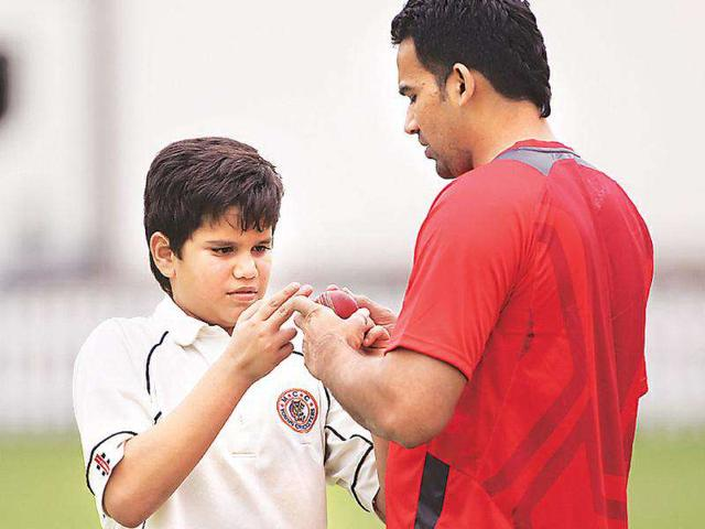Sachin-Tendulkar-s-son-Arjun-gets-some-bowling-lessons-from-Zaheer-Khan-at-the-Lord-s-nets-on-Wednesday--getty-images