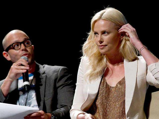 Actress-Charlize-Theron-looks-on-as-she-sits-alongside-moderator-Damon-Lindelof-during-the-20th-Century-Fox-panel-while-talking-about-her-new-movie-Prometheus-in-San-Diego
