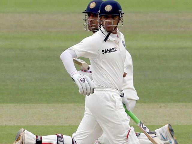 Rahul-Dravid-front-and-MS-Dhoni-back-run-down-the-wicket-past-each-other-against-England-during-Day-three-of-the-1st-Test-match-at-Lord-s-Cricket-Ground-in-London