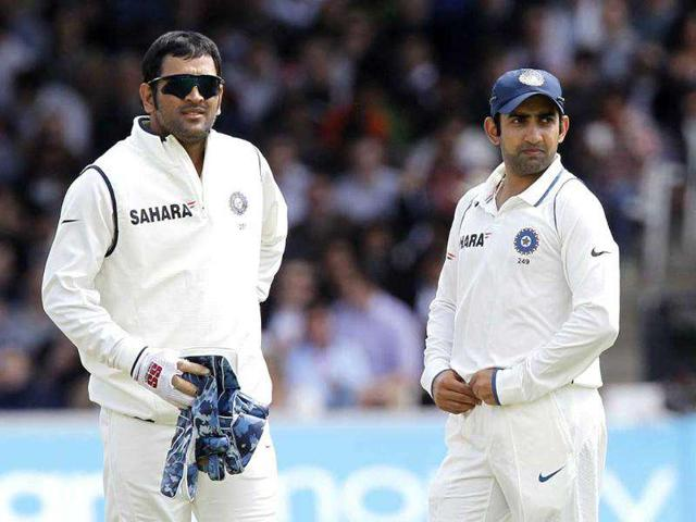 India-s-captain-and-wicketkeeper-MS-Dhoni-L-stands-next-to-Gautam-Gambhir-during-Day-4-of-the-first-Test-match-against-England-at-Lord-s-in-London