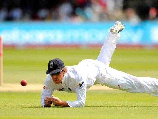 England-s-Graeme-Swann-dives-to-stop-a-ball-during-the-final-day-of-the-first-cricket-Test-match-against-India-at-Lord-s-in-London
