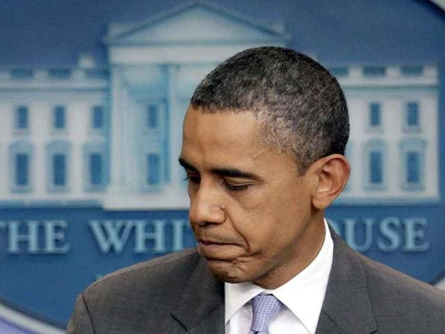 US-President-Barack-Obama-turns-to-leave-after-speaking-from-White-House-briefing-room-in-Washington-about-a-deal-being-reached-to-raise-the-debt-limit