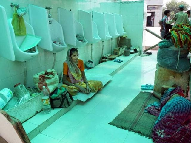Hem-Kumari-who-is-suffering-from-cancer-and-enlargement-of-liver-and-Ramrati-whose-heart-valve-needs-to-be--replaced-have-been-living-inside-public-toilet-since-two-weeks-at-the-Aiims-in-New-Delhi
