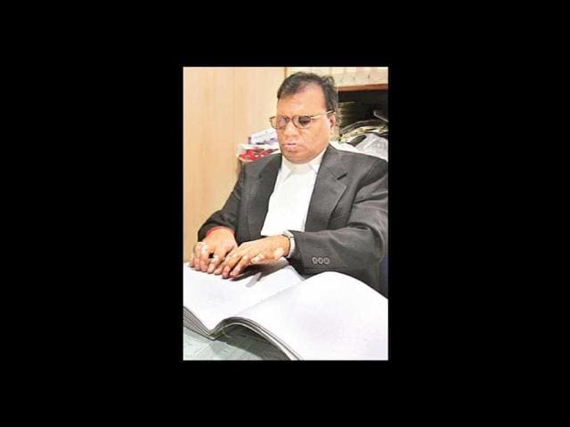 Visually-challenged-lawyer-SK-Rungta-is-seen-reading-his-Braille-notes-at-his-chamber-at-the-Delhi-high-court
