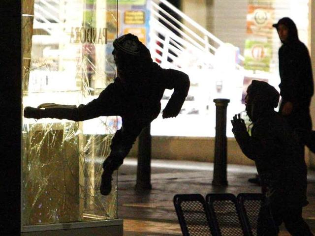 A-woman-jumps-from-a-burning-building-in-Surrey-Street-in-London-in-this-image-taken-from-Twitter-Riots-spread-to-new-areas-of-London-while-looting-also-erupted-in-the-city-of-Birmingham-as-Britain-s-worst-unrest-in-decades-escalated-in-a-third-night-of-violence-There-was-no-information-available-on-the-outcome-of-the-woman-after-this-jump