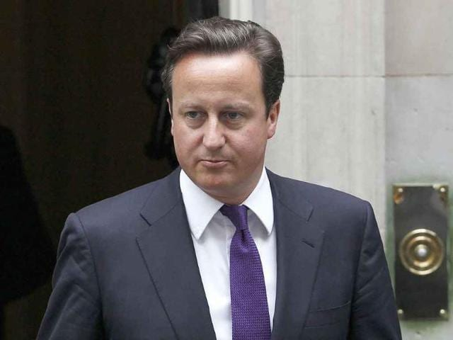 UK-PM-David-Cameron-leaves-his-residence-to-attend-Parliament-in-London