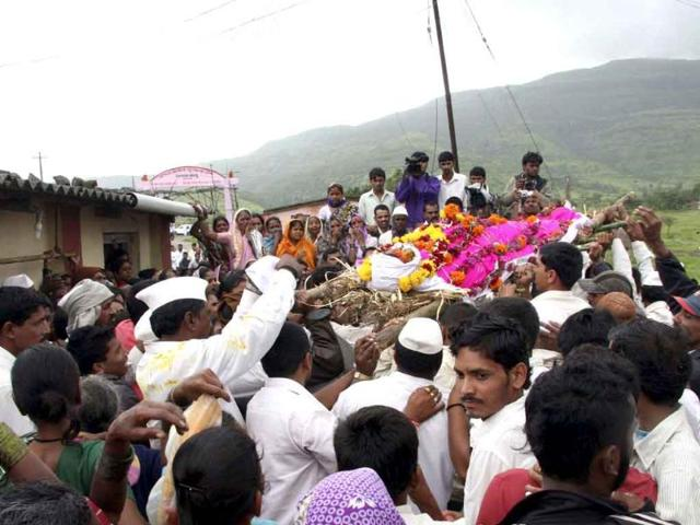 Mourners-carry-the-body-of-a-farmer-killed-by-police-action-during-a-protest-before-a-cremation-ceremony-in-Maval-village-in-Pune