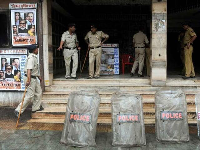 Police-stand-guard-outside-a-cinema-hall-which-is-screening-newly-released-bollywood-film-Aarakshan-in-Mumbai
