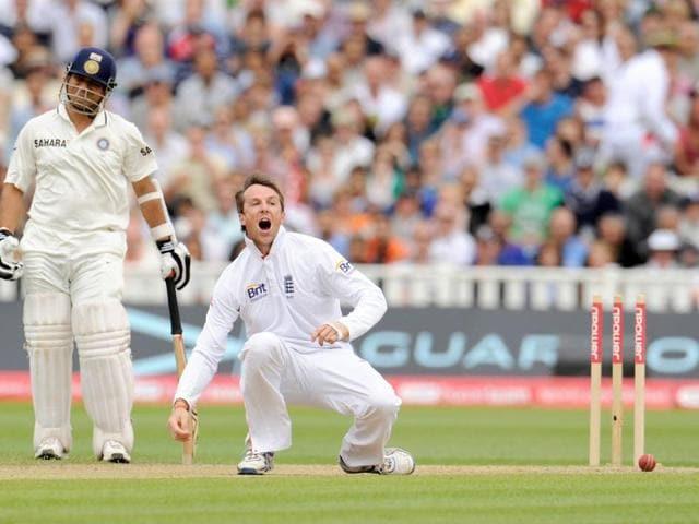 England-s-Graeme-Swann-reacts-after-running-out-India-s-Sachin-Tendulkar-L-during-the-third-cricket-Test-match-at-Edgbaston-cricket-ground-in-Birmingham