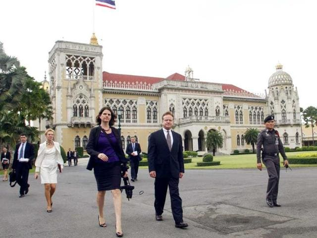 US Senator Jim Webb (D-VA) (2nd R) walks at the Government House after meeting Thailand's first female Prime Minister Yingluck Shinawatra, as part of his Asian Tour, in Bangkok.