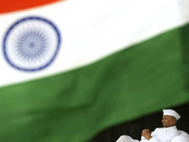 Social-activist-Anna-Hazare-sits-on-the-stage-during-his-hunger-strike-against-corruption-in-New-Delhi