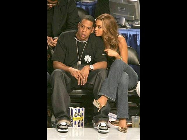 US-singers-Jay-Z-and-Beyonce-watch-Spanish-tennis-player-Rafael-Nadal-play-Serbia-s-Novak-Djokovic-in-the-men-s-US-Open-2011-final-at-the-USTA-Billie-Jean-King-National-Tennis-Center-in-New-York
