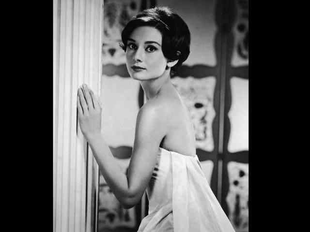 The beautiful Audrey Hepburn (1920 - 1993), born Audrey Kathleen Ruston, sits pretty on No. 5.