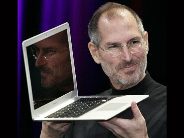 Apple CEO and co-founder Steve Jobs shows off the new Macbook Air ultra portable laptop during his keynote speech at the MacWorld Conference & Expo in San Francisco 15 January 2008.