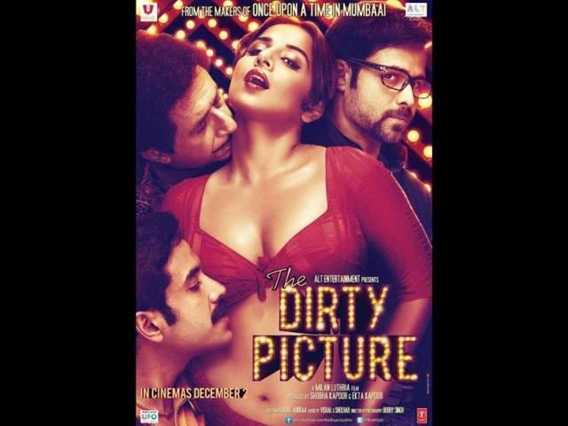 The-Dirty-Picture-Vidya-is-clad-in-a-skimpy-red-blouse-with-three-men-Naseeruddin-Shah-Emraan-Hashmi-and-Tusshar-Kapoor-drooling-over-her
