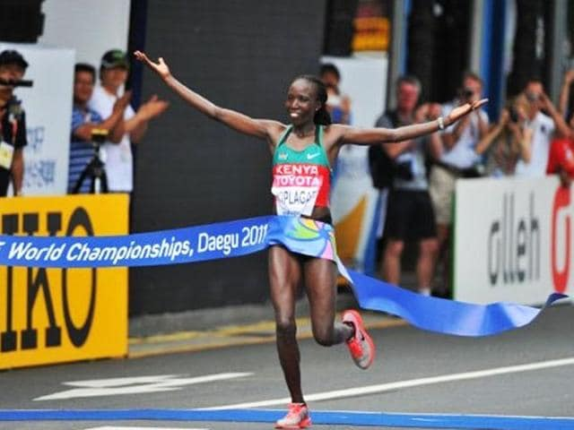 Edna-Kiplagat-of-Kenya-celebrates-after-winning-the-women-s-marathon-event-at-the-International-Association-of-Athletics-Federations-IAAF-World-Championships-in-Daegu
