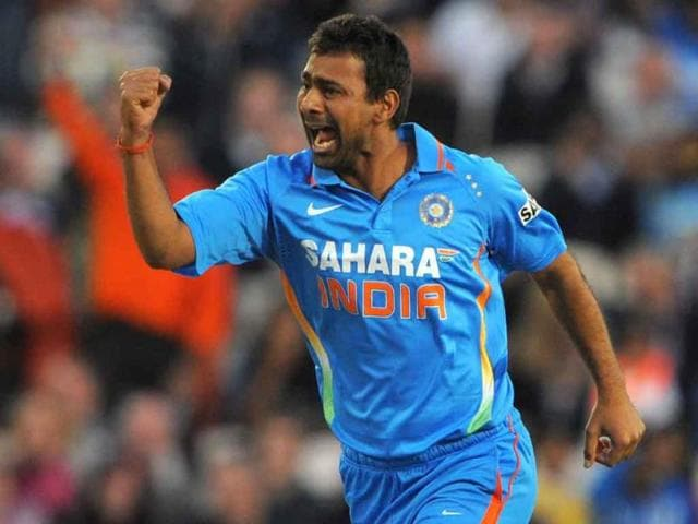 Praveen-Kumar-celebrates-after-taking-the-wicket-of-England-s-Alex-Hales-for-0-during-the-20-20-cricket-match-between-England-and-India-at-Old-Trafford-cricket-ground-in-Manchester